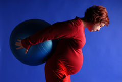 Zuzana with blue ball. Exercise with ball in late pregnancy Stock Images