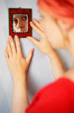 Zuzana in the mirror. Young lady looking at her in the indian style mirror Royalty Free Stock Photo