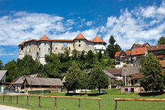 Zuzemberk and medieval castle, Lower Carniola - Slovenia. Zuzemberk lies in the southern part of Carniola on the left bank of the Krka River and is dominated by stock photo