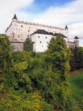 Zvolen Castle on forested hill, Slovakia Stock Image