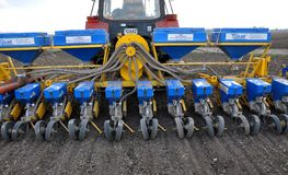 In the field of seed drill precision seeding. Zvynyach - Ternopil - Ukraine - April 5, 2017. To work in the field prepared 12 rows of seed precision seeding Royalty Free Stock Photo