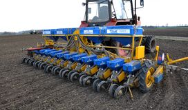 In the field of seed drill precision seeding. Zvynyach - Ternopil - Ukraine - April 5, 2017. To work in the field prepared 12 rows of seed precision seeding Royalty Free Stock Image