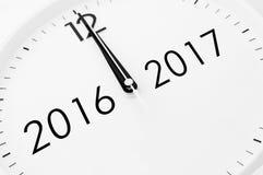 Zwölf Uhr zwischen 2016 und 2017 Stockbilder