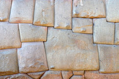 Zwölf versahen Stein in der Inka-Wand mit Seiten stockbild