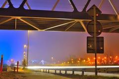 Zwaar verkeer bij nacht, lichtstrepen Royalty-vrije Stock Foto's
