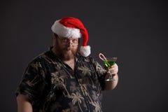 Zwaarlijvige mens in de Hoed van de Kerstman Stock Foto