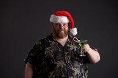 Zwaarlijvige mens in de Hoed van de Kerstman Royalty-vrije Stock Afbeelding