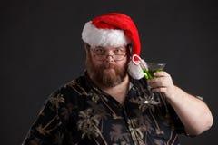 Zwaarlijvige mens in de Hoed van de Kerstman Stock Afbeelding