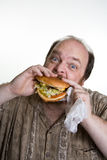 Zwaarlijvige mens die snel voedsel eet Royalty-vrije Stock Foto's