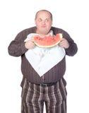 Zwaarlijvige mens die watermeloen eet Royalty-vrije Stock Foto's
