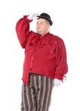 Zwaarlijvige mens in een rode kostuum en bowlingspelerhoed Royalty-vrije Stock Afbeeldingen