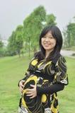 Zwangere Aziatische vrouw Stock Afbeelding