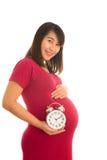 Zwangere de muurklok van de vrouwenholding Stock Fotografie
