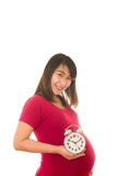 Zwangere de muurklok van de vrouwenholding Zijn tijd Stock Afbeelding
