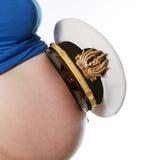 Zwangere jonge vrouw in studio Royalty-vrije Stock Foto's