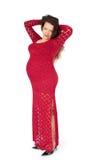 Zwangere vrouw in avondjurk Stock Foto