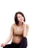 Zwangere vrouw die omhoog kijkt Stock Afbeeldingen