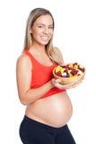 Zwangere vrouw en gezonde snack Royalty-vrije Stock Fotografie