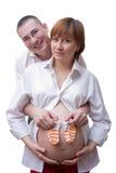 Zwangere vrouw en haar echtgenoot Stock Afbeeldingen