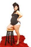 Zwangere vrouw in kleding en hoed. Royalty-vrije Stock Fotografie