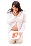 Zwangere vrouw met appelen stock foto