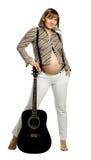 Zwangere vrouw met gitaar Royalty-vrije Stock Foto