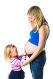 Zwangere vrouw met 2 yodochter Stock Afbeelding