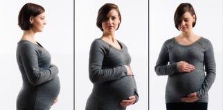 Zwangere vrouw wat betreft haar buik Stock Foto's