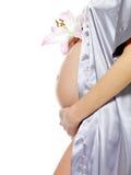 Zwangere vrouwelijke holdingsbuik en bloem Stock Afbeelding