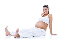Zwangere vrouwenontspanning na het uitoefenen Stock Foto's