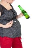 Zwangerschap en slechte gewoonten Stock Foto