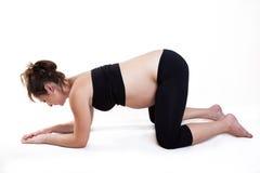 Zwangerschap en yoga Stock Foto