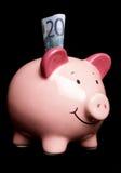 Zwanzig Euro in einer piggy Querneigung lizenzfreies stockbild