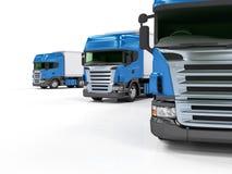 Zware blauwe vrachtwagens die op witte achtergrond worden geïsoleerdo Stock Foto