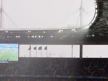 Zware regenonweer tijdens voetbal Stock Afbeeldingen