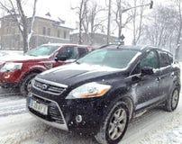 Zware sneeuw die verkeer vertraagt Stock Afbeelding