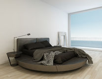 Zwart bed tegen reusachtig venster met overzees/oceaanmening stock illustratie