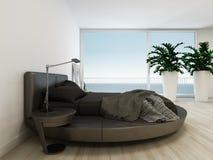 Zwart bed tegen reusachtig venster met overzees/oceaanmening royalty-vrije illustratie