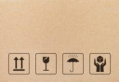 Zwart breekbaar teken en symbool op bruin kartondocument vector illustratie