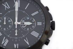 Zwart die horloge op wit wordt geïsoleerd Royalty-vrije Stock Fotografie