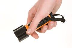 Zwart en oranje ter beschikking gehouden flitslicht Stock Fotografie