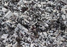 Zwart en rood, grijs houtskoolhout Stock Foto