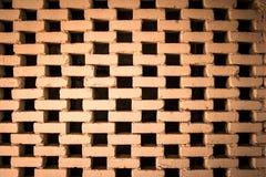 Zwart gat en rode bakstenen muurachtergrond en textuur Stock Foto