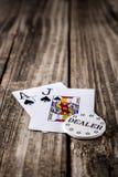 Zwart Jack Poker op Hout stock afbeeldingen