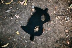 Zwart kindmasker van een knuppelmens royalty-vrije stock afbeeldingen