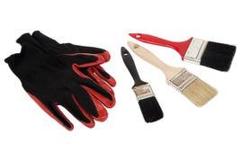 Zwart-rood beschermend handschoen en borstelhulpmiddel Royalty-vrije Stock Afbeeldingen