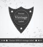 Zwart schildetiket met retro gestileerde wijnoogst Stock Foto