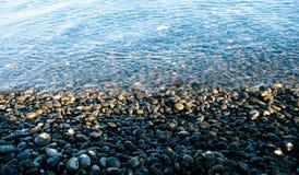 Zwart strand Royalty-vrije Stock Afbeeldingen