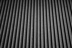 Zwart textuurplastiek met golf Stock Foto's