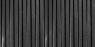Zwart textuurplastiek met golf Stock Afbeeldingen
